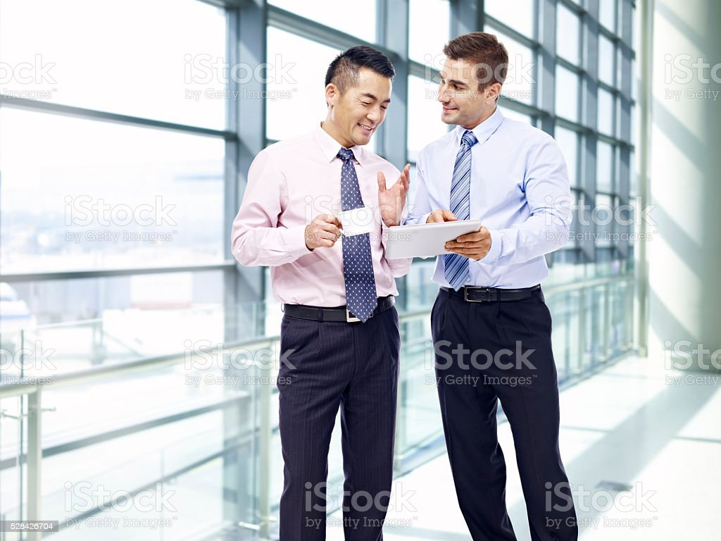 corporate people discussing business at airport stock photo