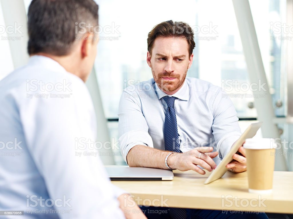 corporate people discussing business in office stock photo