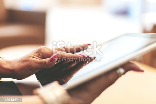 1010774222 istock photo Corporate People Using Digital Tablet Technology Mature Adult in Corporate Office Space in Western Colorado 1159434244