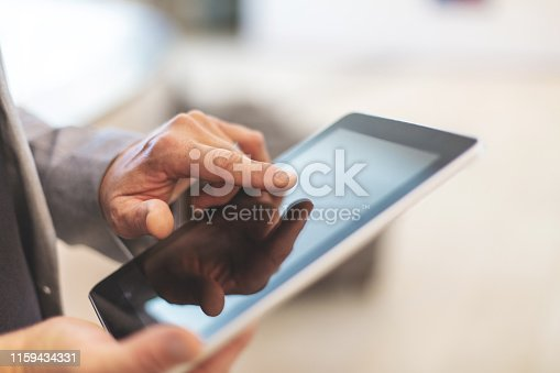 1010774222 istock photo Corporate People Using Digital Tablet Technology Mature Adult in Corporate Office Space in Western Colorado 1159434331