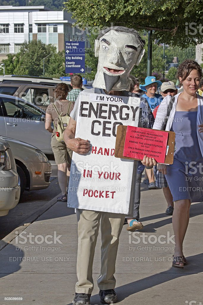 Corporate Personhood Costume and Sign at a Moral Monday Rally stock photo
