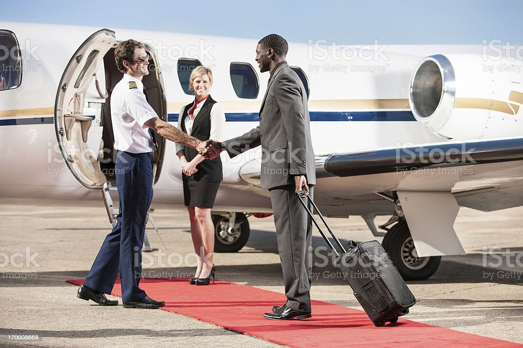 Corporate Pilot Greeting Business Passenger stock photo