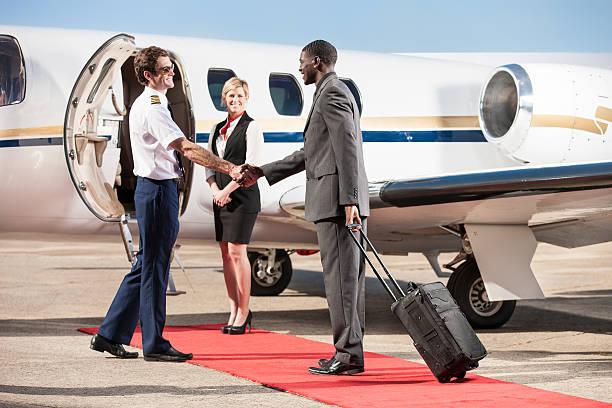 Corporate Pilot Greeting Business Passenger stock photo