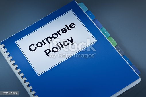 A still life of a working Corporate Policy book. A fundamental document that guide a business venture, its organizational rules, its internal and external conducts and established policy for various conditions and situations.