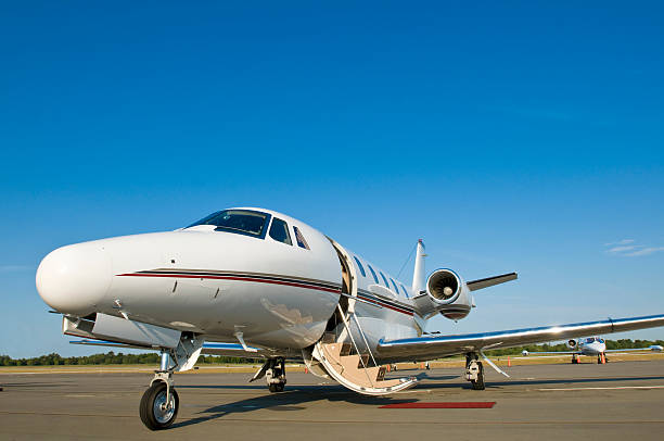 Corporate private jet at airport door open blue sky stock photo
