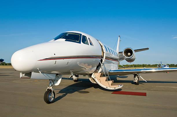 Corporate private jet at airport door open stock photo