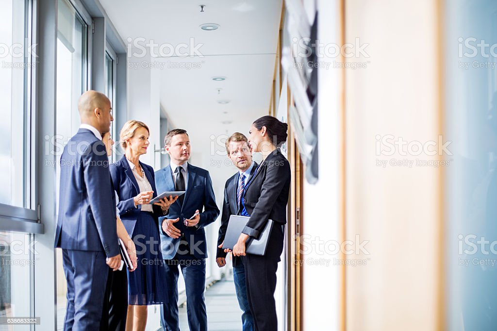 Corporate professional having a standing meeting stock photo