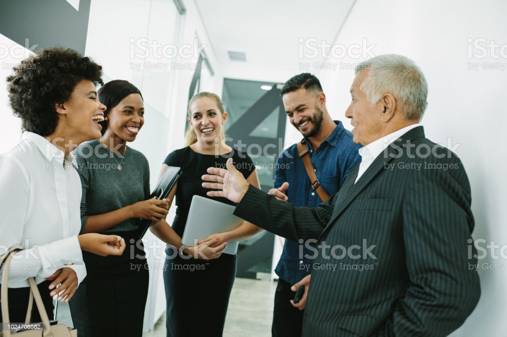Corporate professional having informal meeting stock photo