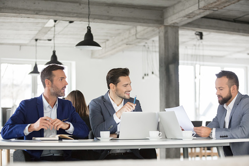 Corporate Professionals Discussing Over A Contract In Meeting Stock Photo - Download Image Now