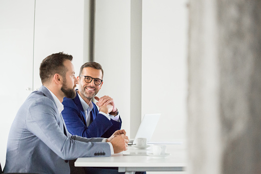 Corporate Professionals During Meeting Stock Photo - Download Image Now