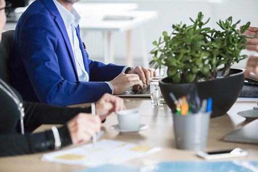 Corporate Professionals Sitting At Meeting Table Stock Photo - Download Image Now