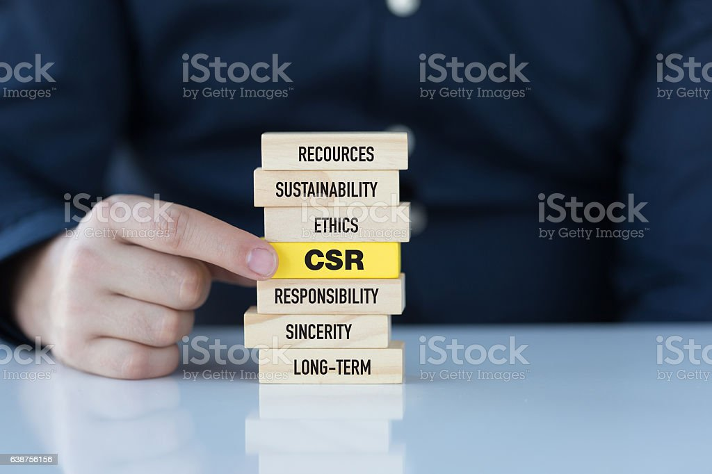 Corporate Social Responsibility Concept with Related Keywords on Wooden Blocks stock photo