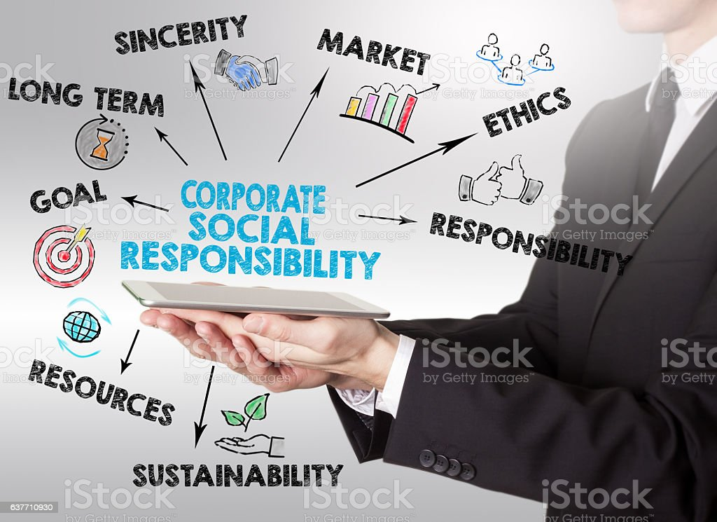 Corporate Social Responsibility Concept, young man holding a tablet computer stock photo