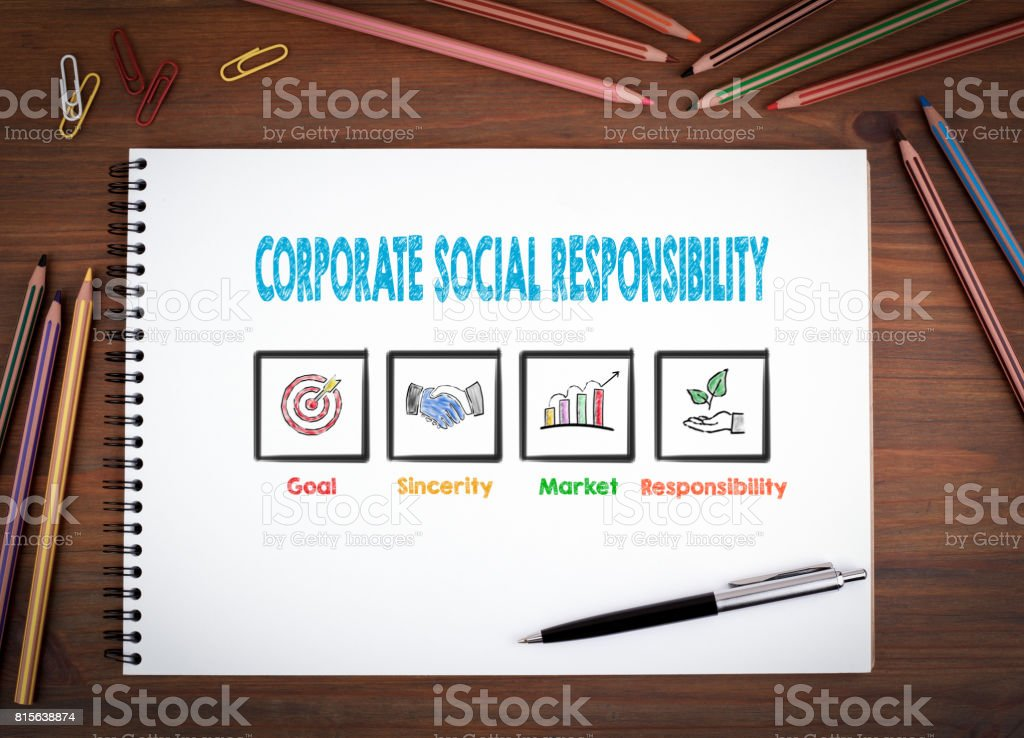 Corporate Social Responsibility. Notebooks, pen and colored penc stock photo