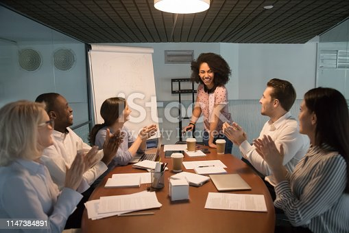 istock Corporate team welcoming biracial business coach starting or finishing seminar 1147384891