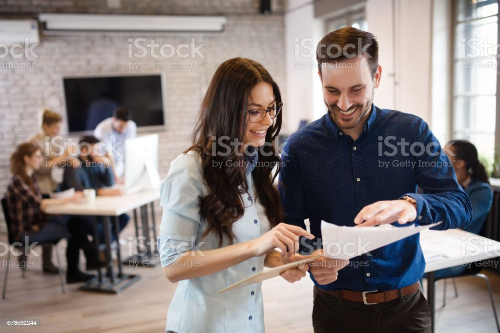 Corporate teamworking colleagues working in modern office stock photo