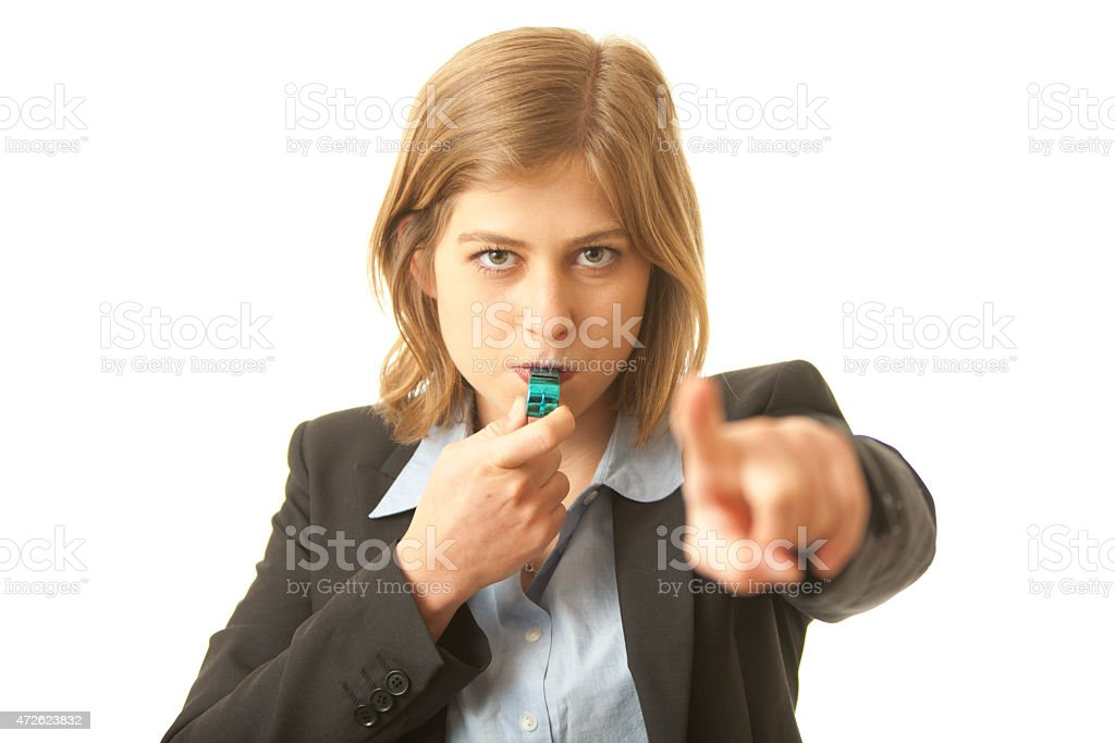 Corporate Whistle Blower Close up of a business woman blowing a whistle and pointing at camera. Concept for corporate whistle blower, or representative of the industry regulator 2015 Stock Photo