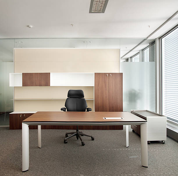 Corporative office Indoor photograph of epmty office space. empty desk stock pictures, royalty-free photos & images
