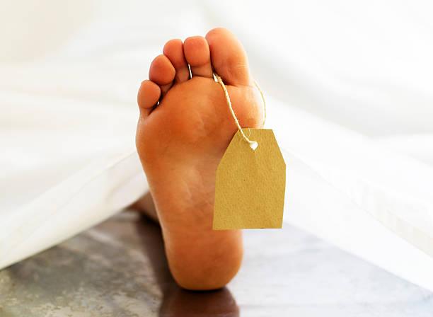 Corpse foot stock photo