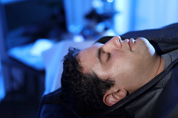 Corpse in body bag in morgue. stock photo