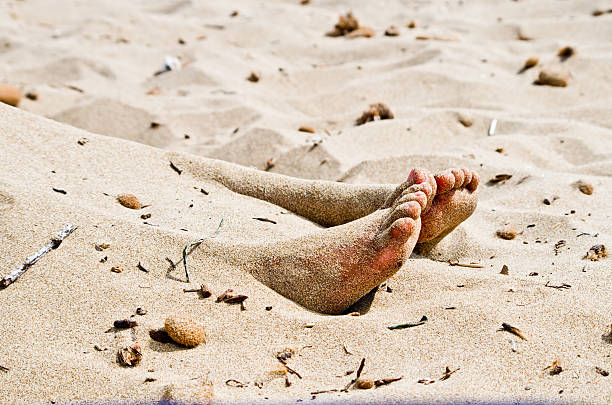 corpse in the sand stock photo