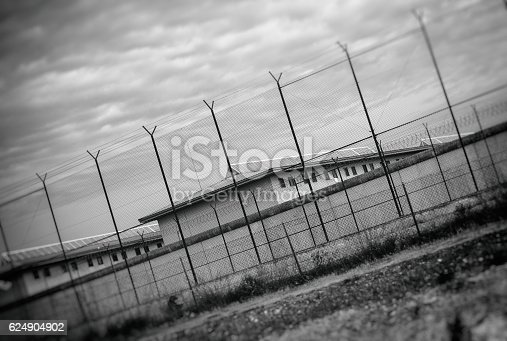 Correctional Facility outside the fence. Black and white.