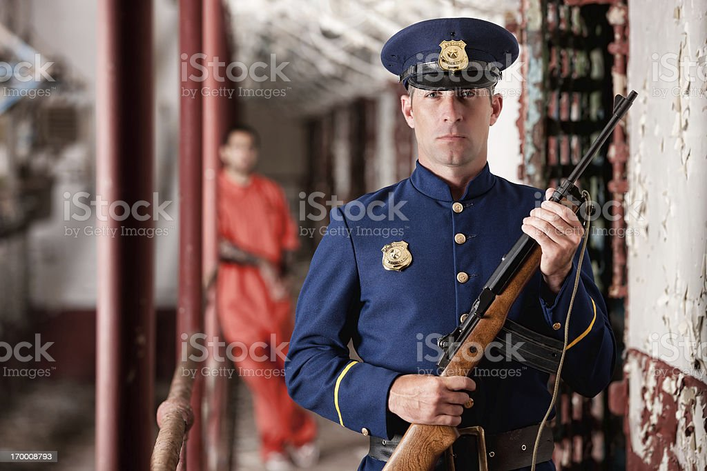 Corrections Officer Guarding Cell Block royalty-free stock photo