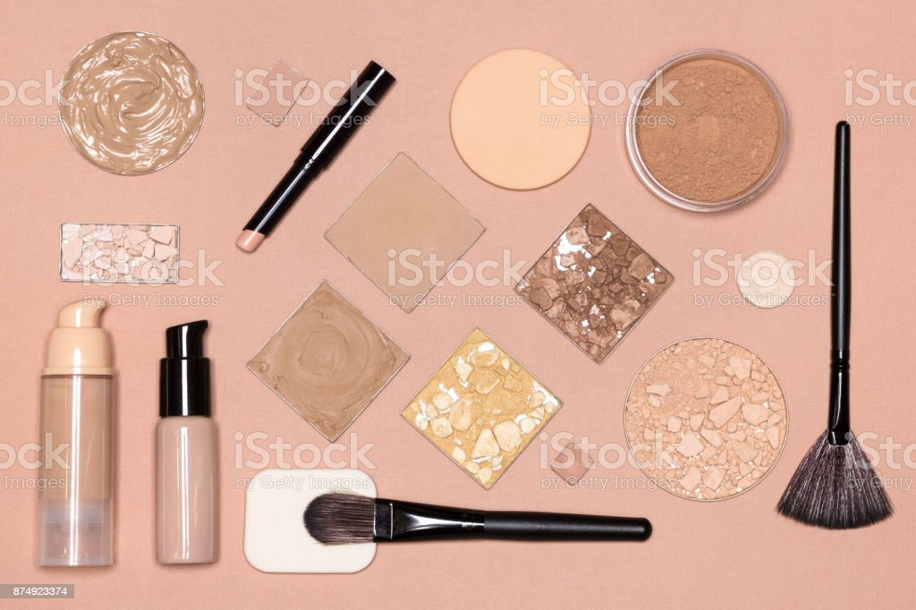 Corrective makeup flat lay set on nude color surface stock photo