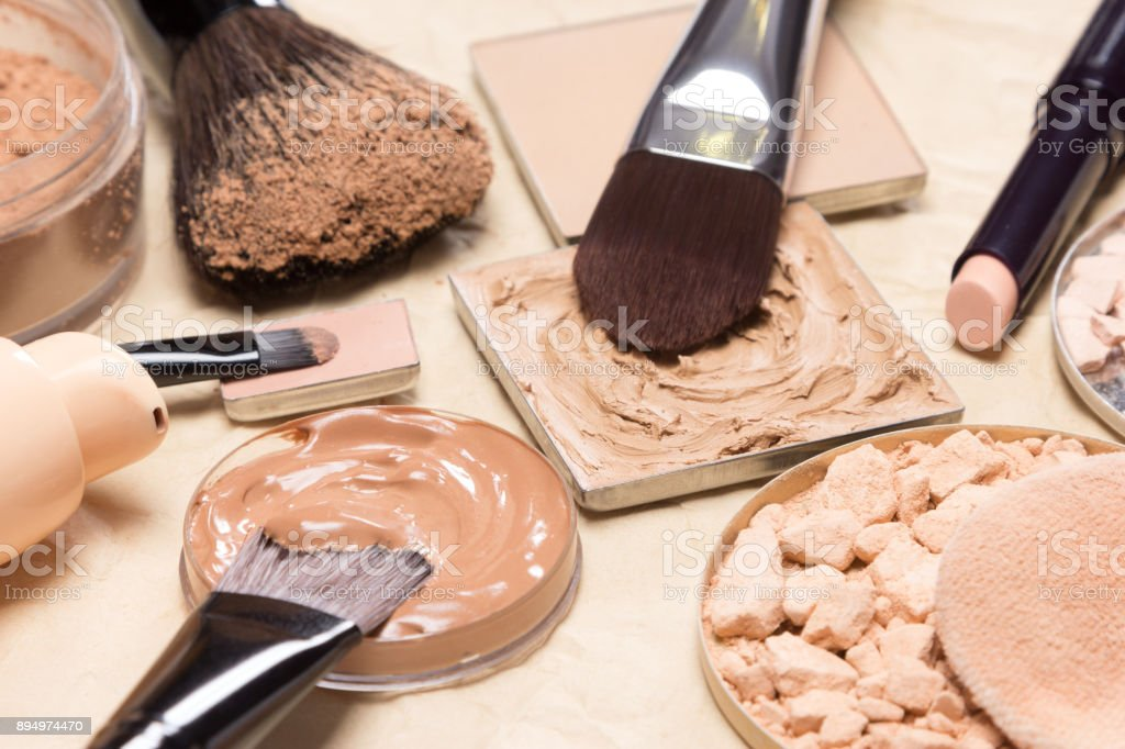 Corrective makeup products and accessories close-up stock photo