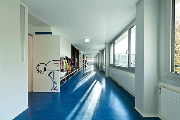 corridor of an elementary school modern public school,  corridor blue floor linoleum stock pictures, royalty-free photos & images
