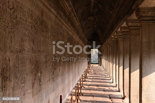 1147569123istockphoto corridor of Angkor wat temple with carvings status on the wall, world heritage, Siemreap, Cambodia 840586806
