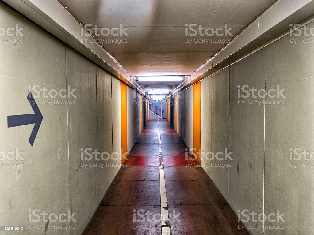Corridor with a arrow sign stock photo