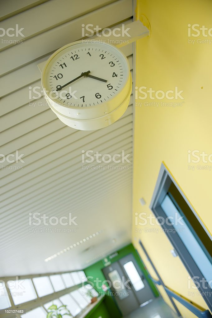corridor with watch, focus on foreground stock photo