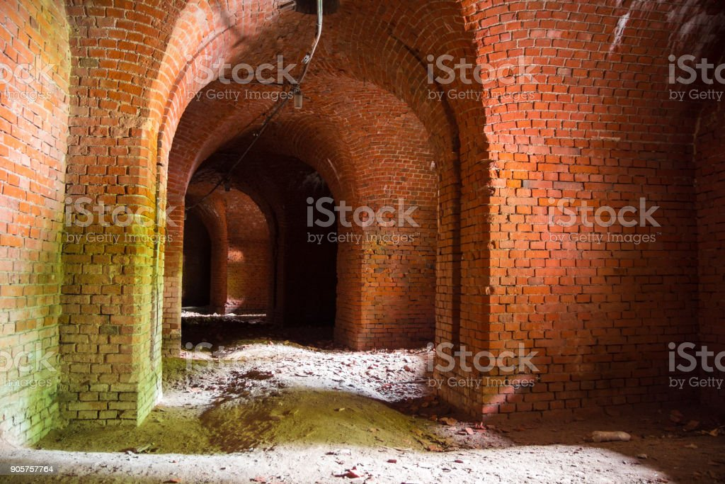 Corridors of the old fortification structure of red brick stock photo