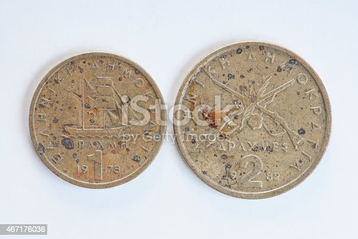 istock Corroded one and two Greek drachma coins 467176036