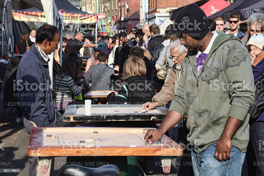 Corrom table game at a market stall in Brick Lane stock photo