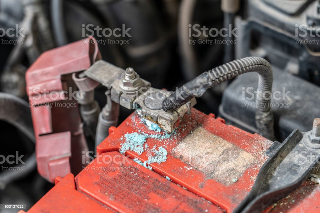 Corrosion build up on car battery terminals, Battery terminals corrode, visible in the form of white powder.Terminal corrosion can eventually lead to an open electrical connection. stock photo
