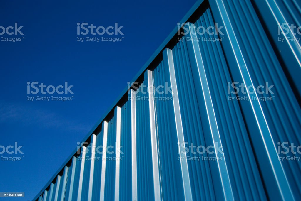 Corrugated blue steel sheet metal facade panels stock photo