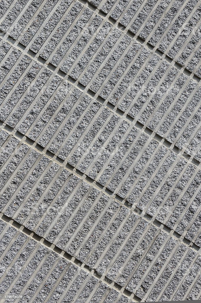 Corrugated Concrete Background showing Pattern of Diagonal Lines royalty-free stock photo