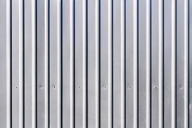 corrugated grey fence steel siding background - alu zaun stock-fotos und bilder