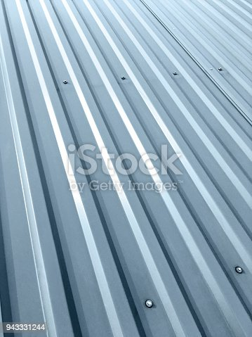 istock corrugated grey metal roof with rivets as background 943331244
