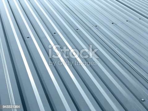 istock corrugated grey metal roof with rivets 943331364