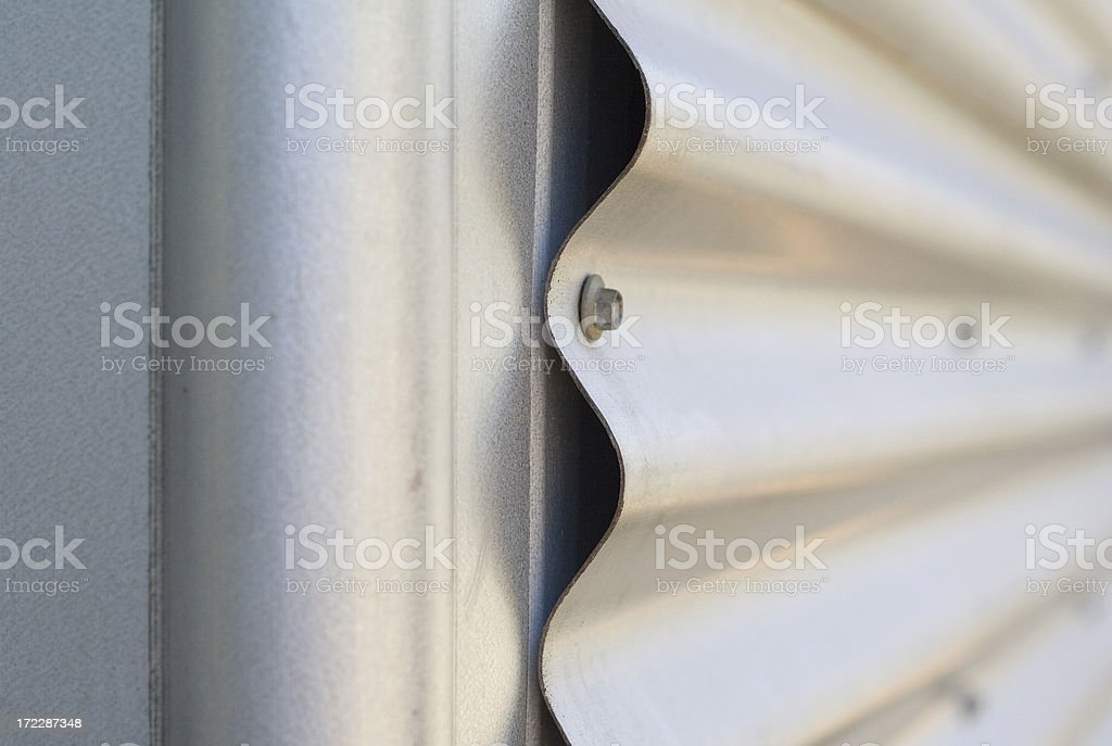 Corrugated iron with fastening screw. royalty-free stock photo
