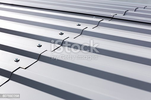 istock corrugated metal cladding on industrial building roof 607592258