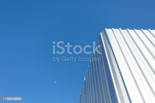 istock Corrugated metal cladding on industrial building wall 1156548983