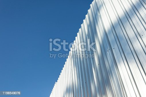 istock Corrugated metal cladding on industrial building wall 1156549076