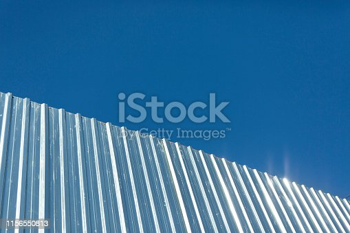 istock Corrugated metal cladding on industrial building wall 1156550813
