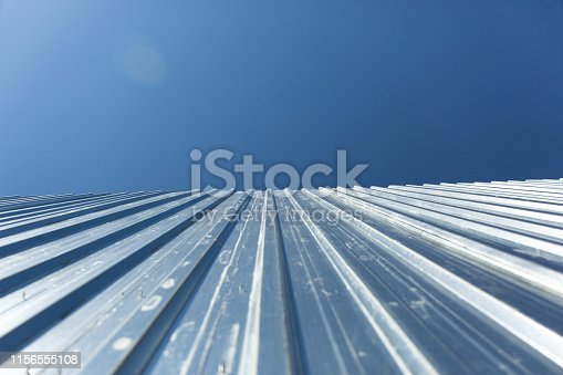 istock Corrugated metal cladding on industrial building wall 1156555108