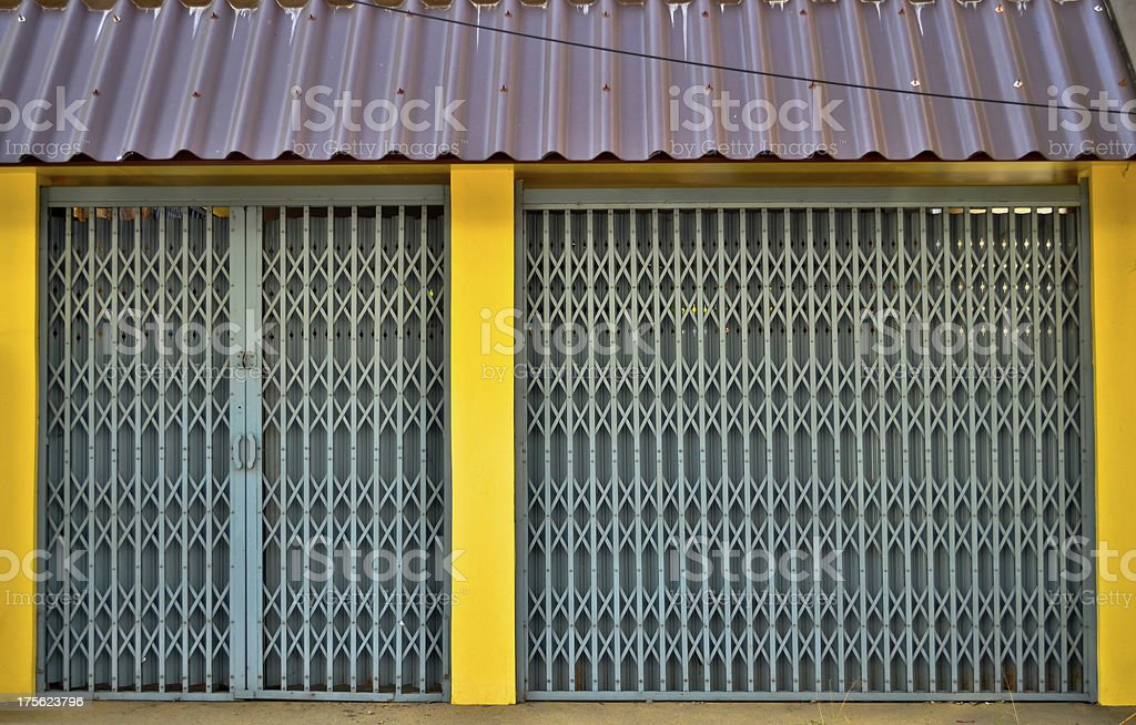 Corrugated Metal Industrial with yellow pole royalty-free stock photo