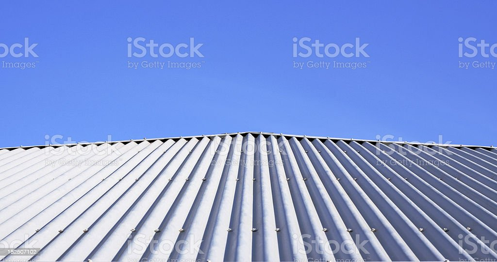 Corrugated Metal Roof and Blue Sky stock photo